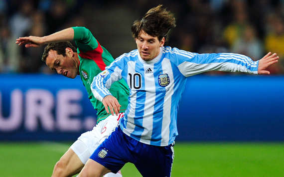Closely guarded. Lionel Messi skips away from his marker as Argentina defeat Mexico 3-1 (Getty Images)