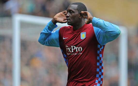 Aston Villa's Emile Heskey listens to the crowd noise as he snatches a late winner at Wolverhampton (Getty Images)