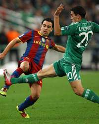 Chapions League ; Xavi Hernandez -  Lazaros Christodoulopoulos Panathinaikos vs Barcelona (Getty Iamges )