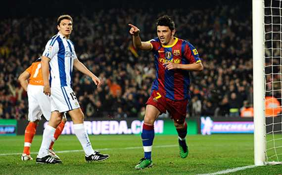 David Villa celebrates after scoring Barcelona's opening goal against Real Sociedad in the 5-0 win (Getty Images)