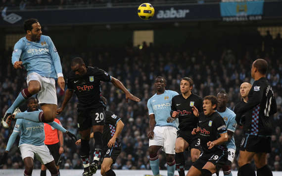 Joleon Lescott towers above Aston Villa's defenders to head Manchester City towards a 4-0 win (Getty Images)