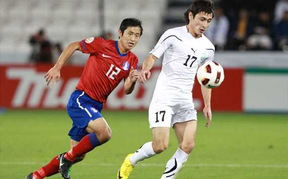 Asian Cup: Uzbekistan - Korea DPR, Lee Young Pyo, Sanjur Tursunov (Getty)
