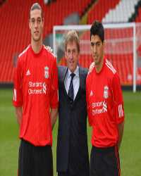 Kenny Dalglish,Andy Carroll,Luis Suarez(Getty Images)