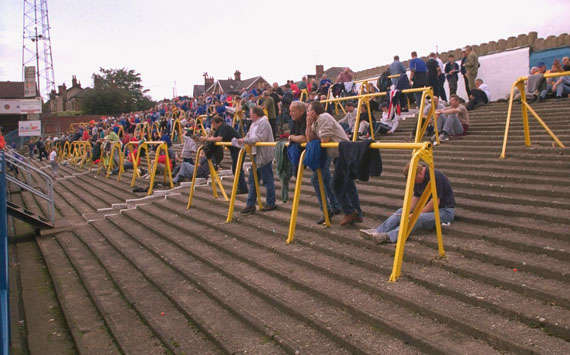 safe standing should be reintroduced to football matches The introduction of safe-standing at premiership football grounds would allow clubs to reduce ticket prices and prove that clubs are prepared to listen to their fans.