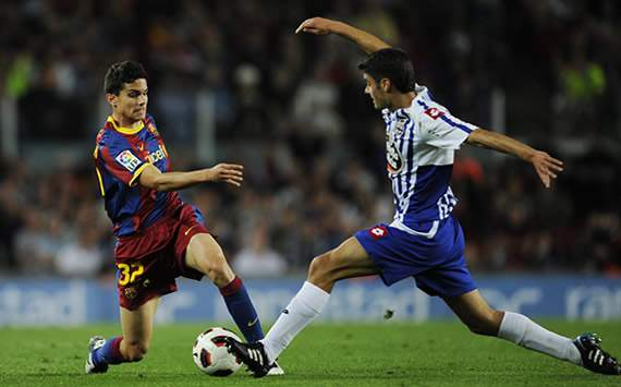 LIGA BBVA: Marc Bartra (FC Barcelona), Juan Domínguez (Deportivo Coruña)