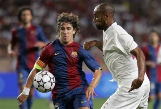 Europe Supercup: Puyol (Barcelona) and Kanoute (Sevilla) (AFP)