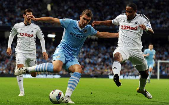 EPL  - Manchester City v Swansea City, Edin Dzeko and Ashley Williams
