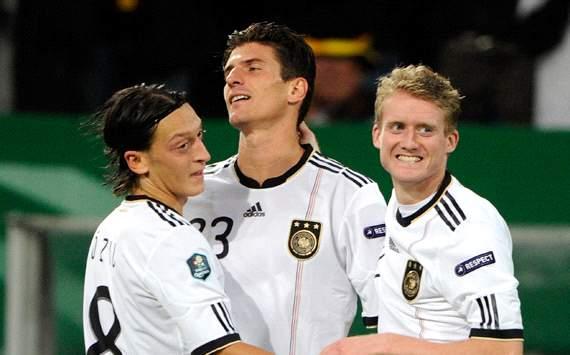 Andre Schürrle; Mesut Özil; Mario Gomez - Germany
