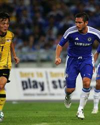 Frank Lampard (R) of Chelsea chases Joseph Kalang of Malaysia during the pre-season friendly match between Malaysia and Chelsea at Bukit Jalil National Stadium on July 21, 2011 in Kuala Lumpur, Malaysia.
