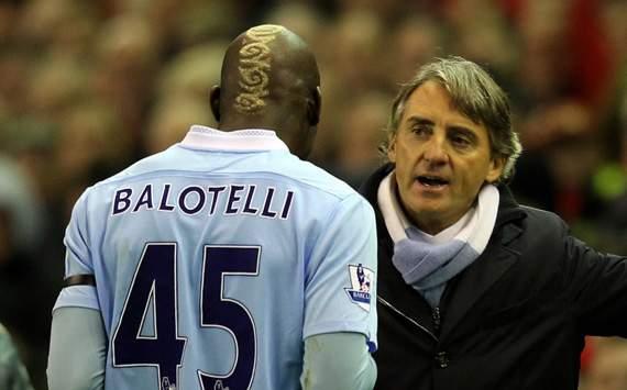 EPL - Liverpool v Manchester City, Mario Balotelli and Roberto Mancini