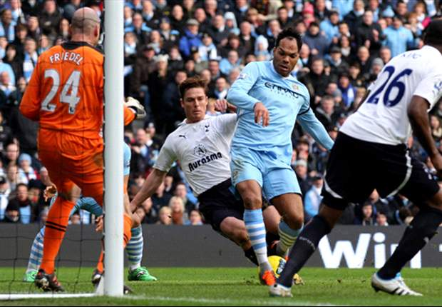 Lescott urges Manchester City fans not to get carried away