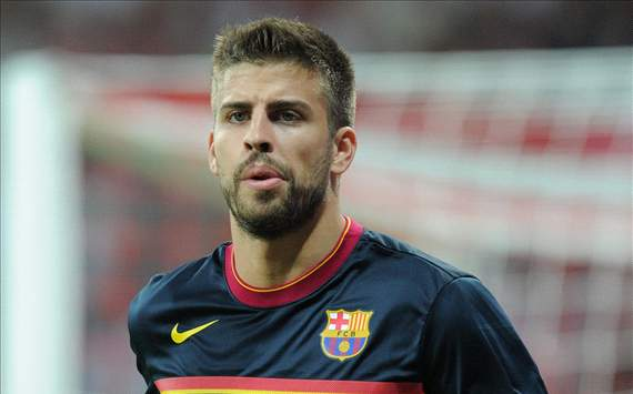 Pique ruled out for up to three weeks with foot injury