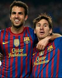 Fabregas and Messi celebrates a goal - Barcelona-Ac Milan (Getty Images)