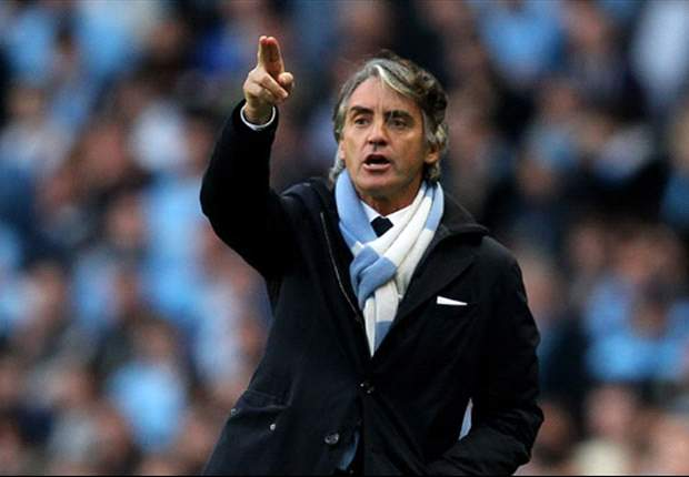 Roberto Mancini meets with Adriano Galliani at AC Milan's headquarters