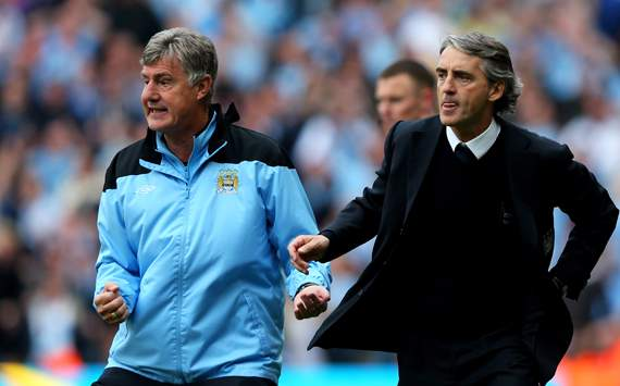 EPL - Manchester City v Queens Park Rangers, Assistant coach Brian Kidd and Roberto Mancini