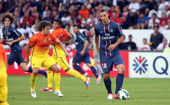 Carles Puyol and Zlatan Ibrahimovic during PSG-Barcelona match