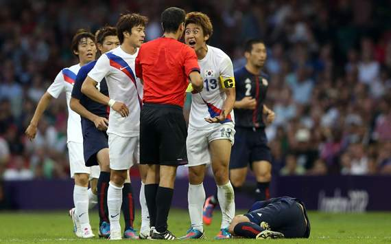 Olympics Day 14 - Men's Football, Korea v Japan, referee Ravshan Irmatov and Jacheol Koo