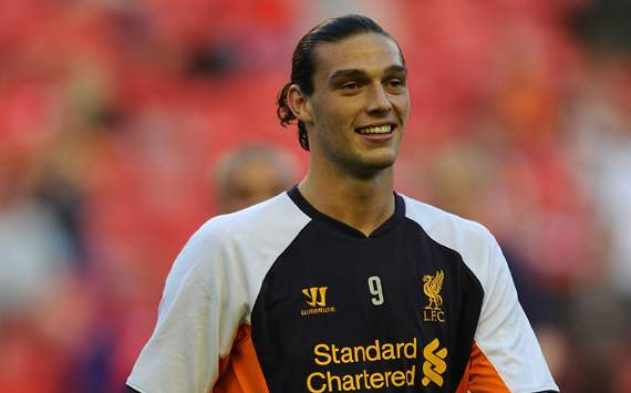 Liverpool in talks with Milan over Carroll loan