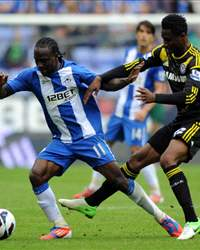 Victor Moses confronts Mikel Obi in the EPL