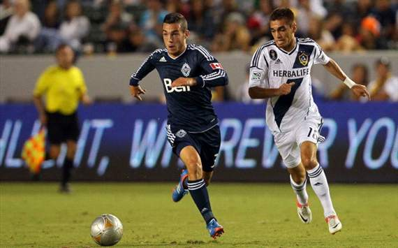 Russell Teibert, Vancouver Whitecaps; Hector Jimenez, LA Galaxy; MLS