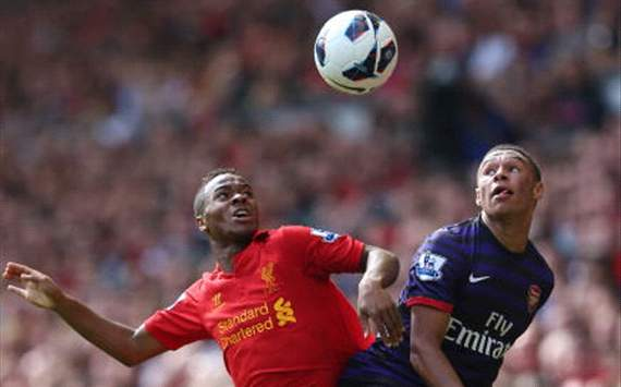 Raheem Sterling of Liverpool battles for the ball with Alex Oxlade-Chamberlain