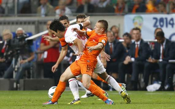 Jordy Clasie and Arda Turan, Netherlands - Turkey