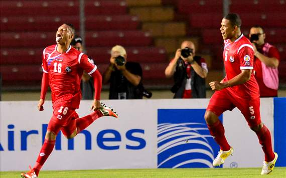 Panama's Rolando Blackburn (L) celebrates with teammate Roman Torres, after scoring against Canada