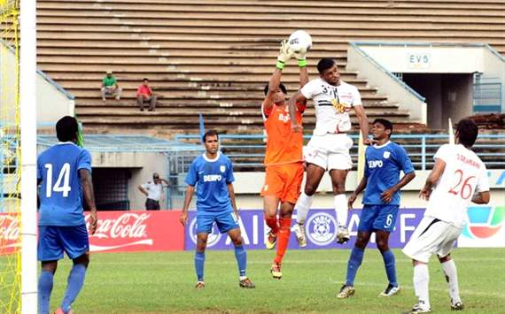 Pailan Arrows Pronoy Halder tries to head the ball past Dempo keeper Subhashish Roychowdhury, Federation Cup 2012