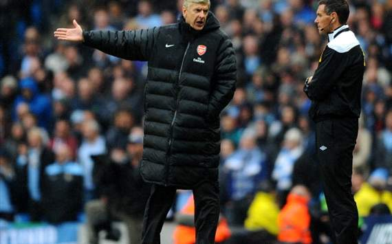 Wenger refuses to rule Arsenal out of title race