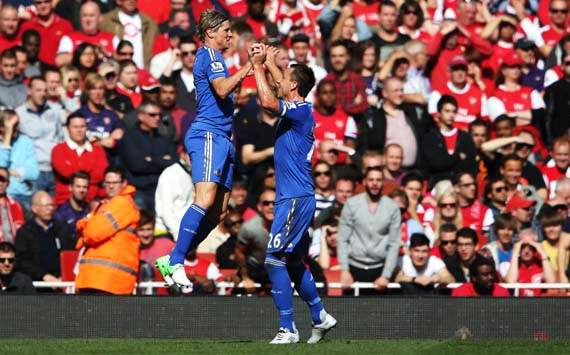 Torres determined to fight for title after Chelsea beat Arsenal to stay top