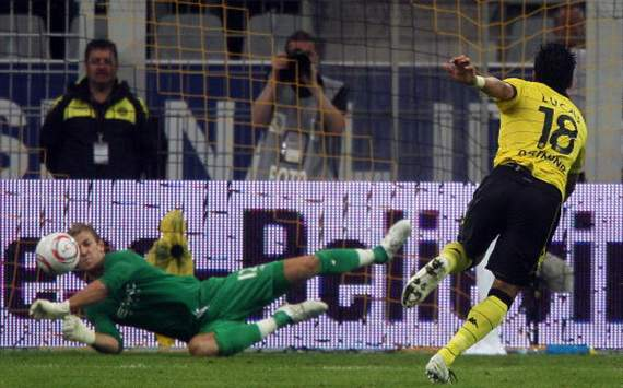 Lucas Barrios of Dortmund shoots a penalty and Joe Hart of Manchester City