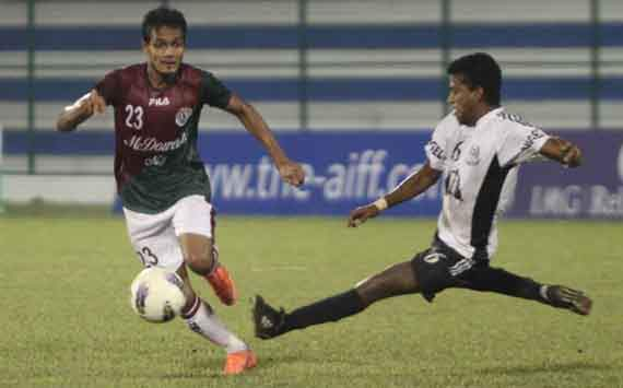 Jewel Raja (left) in action for Mohun Bagan