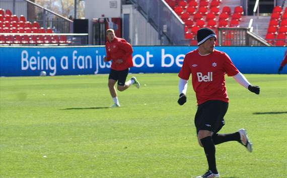 Canada's Iain Hume (front) and Andre Hainault train at BMO Field