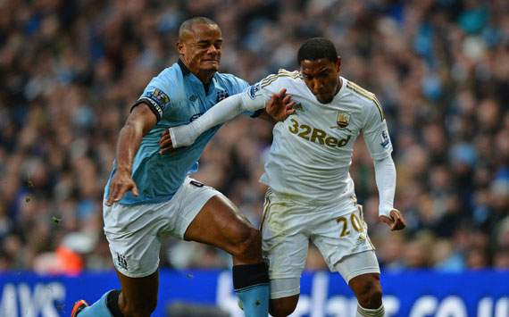 Kompany unconcerned by Manchester City's critics