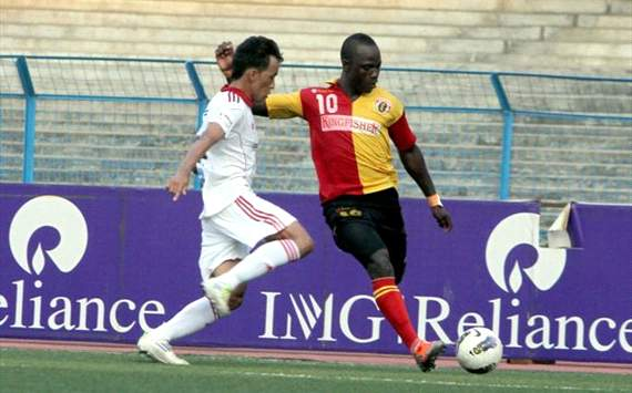 East Bengal's Edeh Chidi tries to get past Pune FC's Karma, I-League