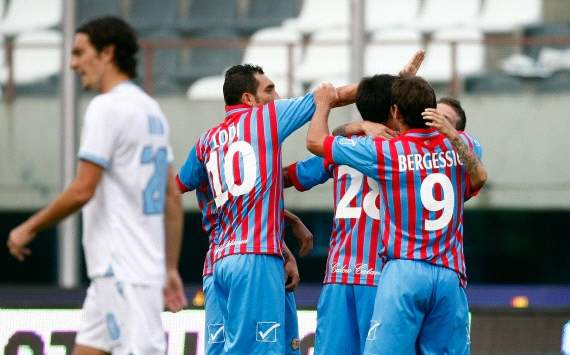 Catania players celebrate a goal against Lazio