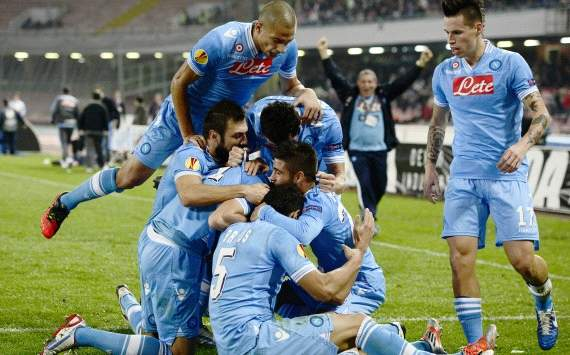 Napoli players celebrate a goal
