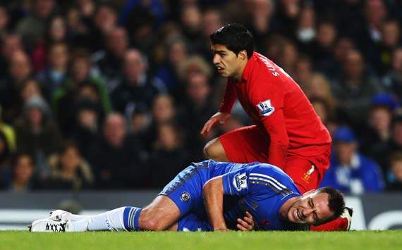 Chelsea captain Terry stretchered off after collision with Suarez