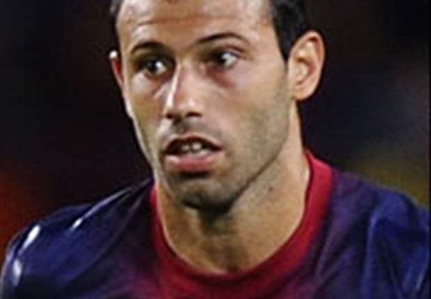 Mascherano lovend over Málaga