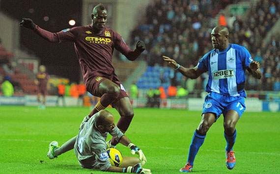 EPL - Wigan Athletic v Manchester City, Ali Al-Habsi and Mario Balotelli