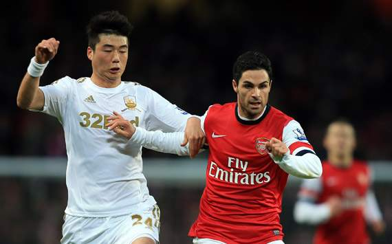 EPL -Arsenal v Swansea City,  Mikel Arteta and Ki Sung-Yong