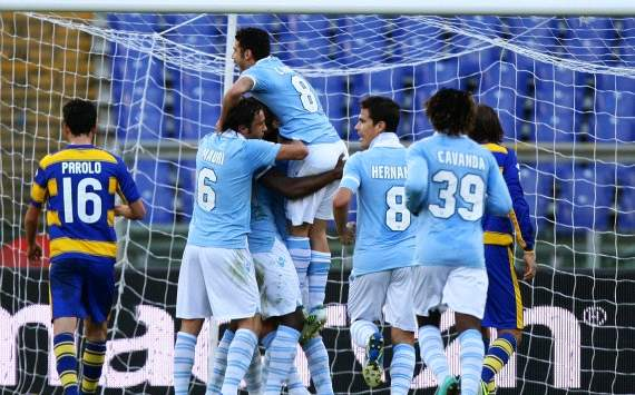 Lazio players celebrate a goal against Parma