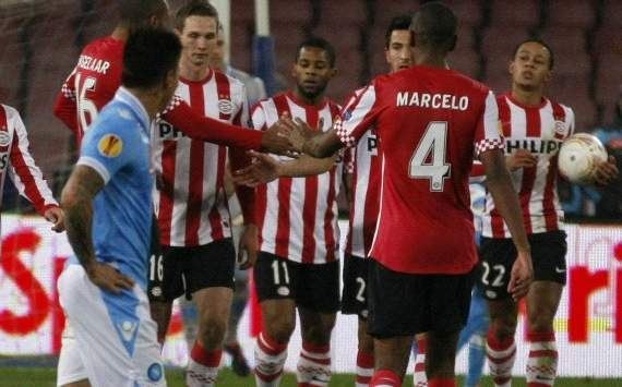 PSV Eindhoven players celebrate a goal against Napoli