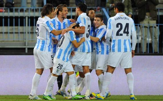 Malaga players celebrate