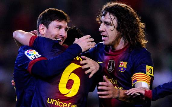 Is Puyol, Xavi & Messi football's greatest spine?
