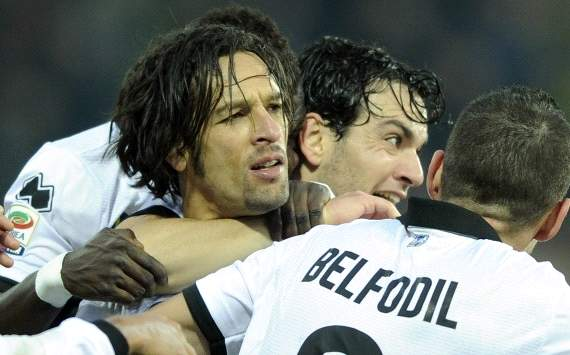 Parma players celebrate Amauri's goal against Palermo