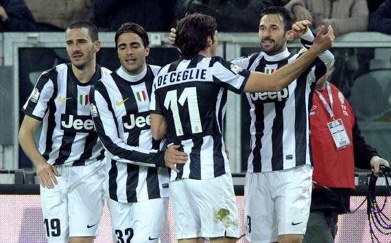 Juventus players celebrate a goal