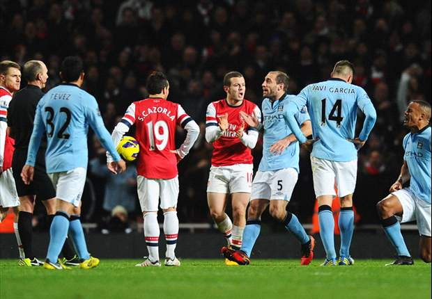 Kompany defends referee Mike Dean after dismissal against Arsenal