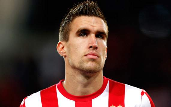 Strootman happy to bide time over move