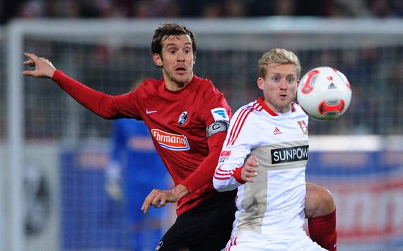 SC Freiburg v Bayer 04 Leverkusen: Julian Schuster &amp; Andre Schrrle